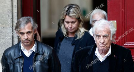 French actor Jean Paul Belmondo, right, his son Paul, left, and his daughter in law, Luana, center, leave the funeral ceremony for French actor Jean Rochefort at the Saint Thomas d'Aquin church in Paris, . French actor Jean Rochefort, who starred in more than 100 movies over a half-century and was much loved by the French public, has died. He was 87