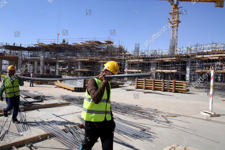 People work at a construction site at the New Administrative Capital, 45 kilometers east of Cairo, Egypt, 18 October 2017. The new city is located 45 kilometers east of Cairo, in an area halfway to the seaport city of Suez. Egypt's Prime Minister Sherif Ismail said in September 2017 that Egypt's state institutions will be moved to New Administrative Capital by the end of 2018.