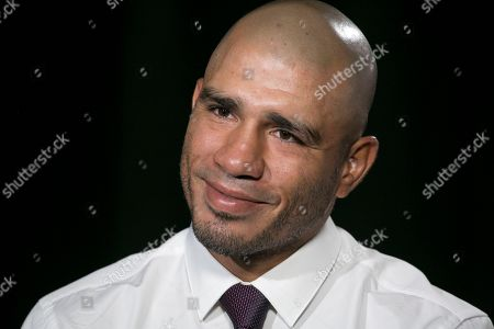 Boxer Miguel Cotto talks during an interview, in New York. Cotto will bid farewell to the ring after facing Sadam Ali in a junior middleweight bout on Dec. 2 at Madison Square Garden