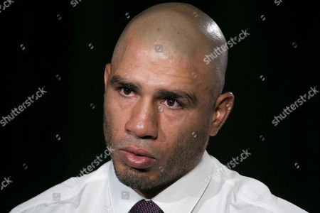 """Boxer Miguel Cotto talks during an interview, in New York. Cotto faces Sadam Ali in a junior middleweight bout on Dec. 2 at Madison Square Garden. Cotto guaranteed there will be no going back on his word, and said he is """"150 percent"""" sure he will hang up the gloves after the bout against the 29-year-old Brooklyn native"""