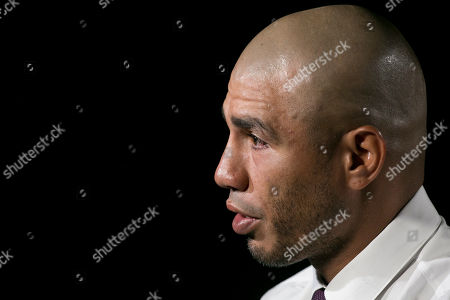 """Boxer Miguel Cotto talks during an interview, in New York. Cotto will bid farewell to the ring when he faces Sadam Ali on Dec. 2 in Madison Square Garden _ his """"second home,"""" as he calls it, where he will fight for the 10th and final time of his career"""