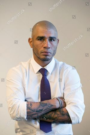 """Boxer Miguel Cotto poses for a portrait, in New York. Cotto will bid farewell to the ring when he faces Sadam Ali on Dec. 2 in Madison Square Garden _ his """"second home,"""" as he calls it, where he will fight for the 10th and final time of his career"""
