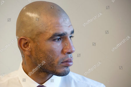 Boxer Miguel Cotto poses for a portrait, in New York. Cotto faces Sadam Ali in a junior middleweight bout on Dec. 2 at Madison Square Garden