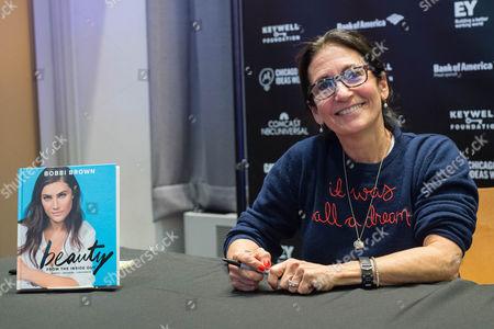 Cosmetics guru Bobbi Brown signs copies of her new book for fans.