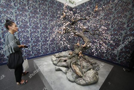 A visitor looks at a work of art entitled 'Moon Howlers' by Indian-born artist Raqib Shaw at the 2017 FIAC, or Foire Internationale d'Art Contemporain (International Contemporary Art Fair), at the Grand Palais in Paris, France, 18 October 2017. The fair runs from the 19 to 22 October.