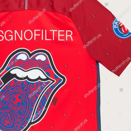 """The Rolling Stones have teamed up with football club Paris Saint-Germain to launch a new fashion collection.  The 'Paint It Black' hitmakers and the French soccer side will release a special limited-edition range of items to celebrate the group's 'No Filter European Tour', which will conclude with a trio of shows at the U Arena in Paris on October 19, 22 and 25.  Created in partnership with Bravado, the capsule collection - a range of essential items which don't go out of fashion - includes a red #PSGNOFILTER football shirt and a hooded sweatshirt, as well as limited-edition Nike Air Max trainers, a skate deck and a bike helmet.  The designs come in the Paris club's red and blue colors and also contain the rockers' famous """"tongue and lips"""" logo, which was designed in 1971 by John Pasche and has been used on a number of their LP covers and merchandise creations since."""