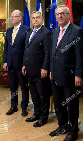 European Commission President Jean-Claude Juncker, right, poses for a group photo with leaders of the Visegrad group at EU headquarters in Brussels on . From left, Czech Republic's Prime Minister Bohuslav Sobotka and Hungarian Prime Minister Viktor Orban