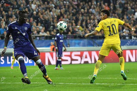 Anderlecht's Kara Mbodji, left, and PSG's Neymar vie for the ball during a Champions League Group B soccer match between Anderlecht and Paris Saint-Germain at the Constant Vanden Stock stadium in Brussels, Belgium