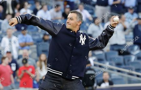 Andy Pettitte throws out the ceremonial first pitch before Game 5 of baseball's American League Championship Series between the Houston Astros and the New York Yankees, in New York