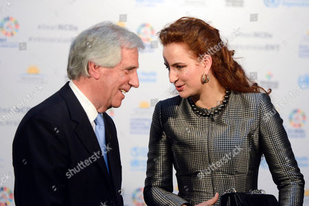 Uruguay's President Tabare Vazquez, left, speaks with Morocco Princess Lalla Salma before the family photo as they participate in the World Health Organization conference on noncommunicable diseases in Montevideo, Uruguay