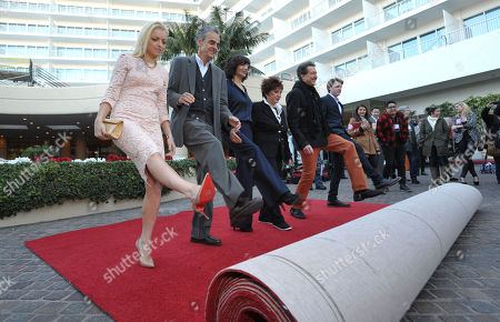 From left, Miss Golden Globe Francesca Eastwood, Dick Clark Productions CEO Allen Shapiro, Dick Clark Productions President Orly Adelson, HFPA President Aida Takla-O'Reilly, producer Barry Adelman, and Mr. Golden Globe Sam Michael Fox roll out the red carpet at the Golden Globe Awards preview day at the Beverly Hilton Hotel, in Beverly Hills, Calif