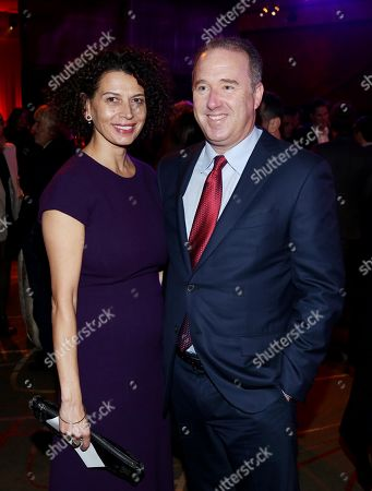 """Matthew Baer, right, and Donna Langley pose together at the after party for the Los Angeles premiere of """"Unbroken"""" on"""