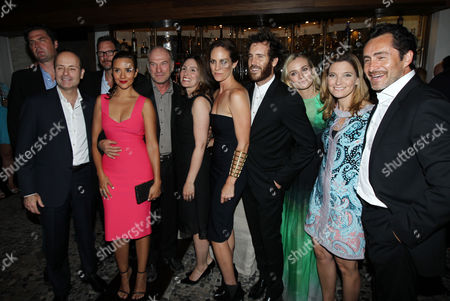 "From left, Elwood Reid, John Landgraf, Matthew Lillard, Catalina Sandino Moreno, Ted Levine, Carolyn Bernstein, Annabeth Gish, Thomas M. Wright, Diane Kruger, Meredith Stiehm, Demian Bichir pose together at the after party for the premiere screening of ""The Bridge"" at the Red O on in Los Angeles"