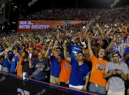 "Florida fans wave cell phone lights and sing the Tom Petty song ""I Won't Back Down"" at the beginning of the fourth quarter of the team's NCAA college football game against Texas A&M in Gainesville, Fla. This is a new tradition to honor Gainesville native Tom Petty, who died earlier this month"
