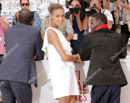 From left, director Mahamat-Saleh Haroun, actors Anais Monory and Souleymane Deme pose for photographers during a photo call for the film Grigris at the 66th international film festival, in Cannes, southern France