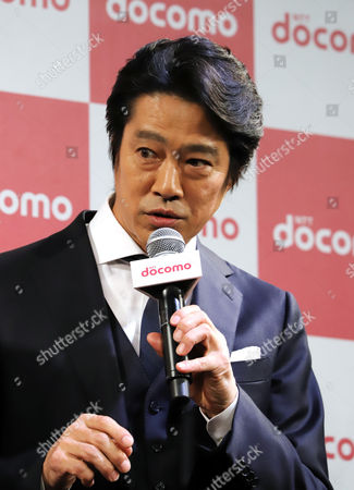 Japanese actor Shinichi Tsutsumi attends a promotional event of Japan's mobile communication giant NTT Docomo