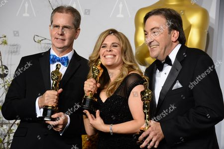 "Chris Buck, from left, Jennifer Lee and Peter Del Vecho pose in the press room with the award for Best animated feature film of the year for ""Frozen"" during the Oscars at the Dolby Theatre, in Los Angeles. On Saturday, May 17, 2014, Lee, speaking at the University of New Hampshire commencement, encouraged University of New Hampshire graduates to do away with self-doubt"