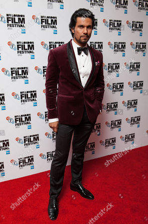 Actor Randeep Hooda poses for photographers upon arrival at the Premiere of the film Beeba Boys, showing as part of the London Film Festival, in central London