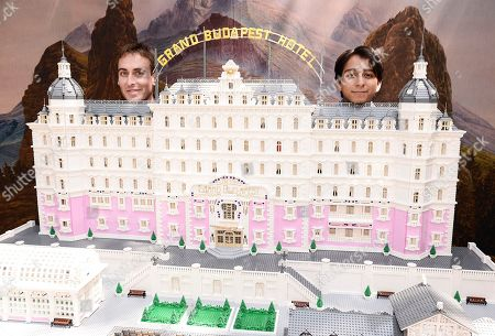 """Actor Tony Revolori and builder Ryan Ziegelbauer unveil a remarkable model inspired by Wes Anderson's """"The Grand Budapest Hotel"""" and constructed entirely of Lego bricks at The Grove in Los Angeles on . Built to commemorate """"The Grand Budapest Hotel"""" Blu-ray and DVD release on Tuesday, June 17, the model includes 50,000 Lego bricks, weighs approximately 150 pounds and stands 7 feet tall and 6.5 feet wide"""