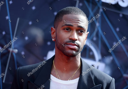 Big Sean arrives at the BET Awards at the Microsoft Theater in Los Angeles. Authorities say a shooting happened late Monday, Aug. 3, outside the PNC Bank Arts Center in Holmdel, N.J., where hip hop artists J. Cole and Big Sean performed at the venue