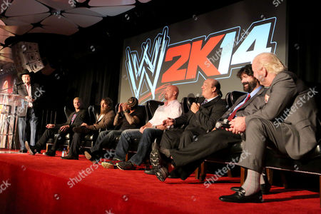 Left to Right) Jim Ross, Dolph Ziggler, Daniel Bryan, Rey Mysterio, Stone Cold Steve Austin, Paul Heyman, Mick Foley and Ric Flair discuss their favorite WrestleMania moments at the WWE 2K14 press event, on in Los Angeles