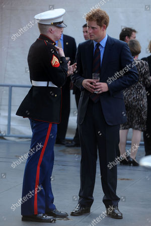 New York - June 25: Prince Harry (r) Speaks with U S Marine Veteran Aaron Mankin On the Deck of the Us Intrepid June 25 2010 in New York City Prince Harry is On a Three Day Trip to New York Culmulating On Sunday where He Will Play in a Polo Match Supporting His Charity Sentebale People: Prince Harry ***no Uk*** United States of America Manhattan