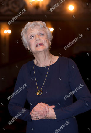 British actress and singer Dame Angela Lansbury is photographed on stage at the Gielgud Theatre in central London, as she returns to the West End this spring for the first time in nearly 40 years, with the play, Blithe Spirit, by Noel Coward, . Dame Angela reunites with director Michael Blakemore to reprise her role as Madame Arcati