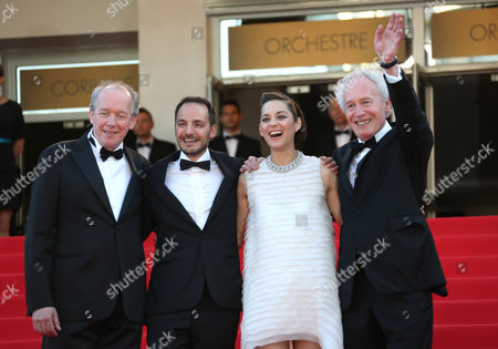 """From left, Luc Dardenne, Fabrizio Rongione, Marion Cotillard and Jean-Pierre Dardenne on the red carpet for the screening of """"Two Days, One Night"""" (Deux jours, une nuit) at the 67th international film festival, Cannes, southern France. No filmmakers have better documented working class lives like the Dardenne brothers, who have continually returned to their Belgian hometown of Seraing to dramatize the daily struggles to get by. In their latest, """"Two Days, One Night,"""" they work with a bigger star, Cotillard, than they ever have before"""
