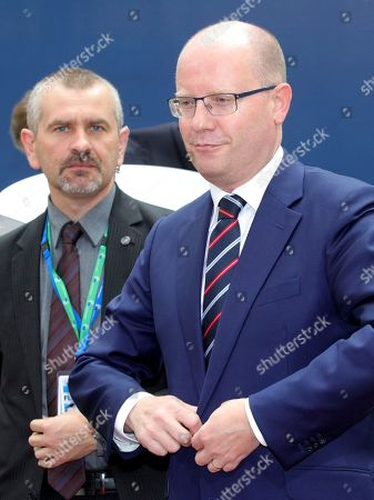 Czech Republic's Prime Minister Bohuslav Sobotka, right, arrives for an EU summit in Brussels on . British Prime Minister Theresa May headed to a European Union summit Thursday with a pledge to treat EU residents well once Britain leaves the bloc