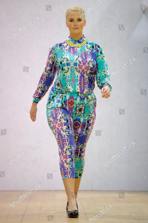 Stock Image of Model Whitney Thompson wears a design during the Plus Size Fashion event during London Fashion Week Autumn/Winter 2014, at Vinopolis in central London