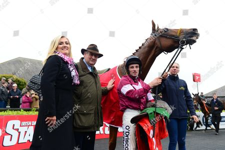 PUNCHESTOWN. ROAD TO RESPECT and Sean Flanagan with trainer Noel Meade, his wife Derville and groom Karen Kelly after their win.