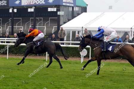 Stock Image of Sir Ivan and Noel Fehily win the Marston's 61 Deep Chase at Uttoxeter.