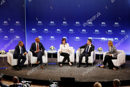 Mel Martinez, Wes Moore, Jean Case, Jeffrey Rosen, Holly Kuzmich. J.P. Morgan Chase Chairman of the Southeast U.S. and Latin America Mel Martinez, left, CEO of the Robin Hood Foundation Wes Moore, second from left, CEO of the Case Foundation Jean Case, center, CEO of the National Constitution Center Jeffrey Rosen, second from right, and moderator Holly Kuzmich participate in a panel discussion at a forum sponsored by the George W. Bush Institute in New York