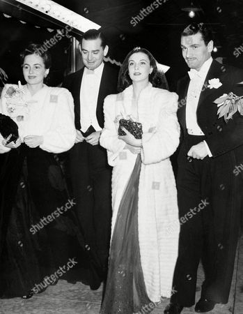 "Stock Photo of From left to right: actress Olivia Mary de Havilland, film investor Jock Whitney, actress Vivien Leigh, and actor Laurence Olivier, as they arrive for the Hollywood premiere of ""Gone With The Wind,"" Jan. 5, 1940. (AP Photo)"