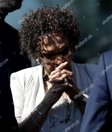 Stock Image of Cissy Houston, mother of the late singer Whitney Houston, gets chocked up before participating in the ribbon cutting during the grand opening of the Grammy Museum Experience at Prudential Center, in Newark, N.J. The museum features items used by Whitney Houston during the Grammy Awards