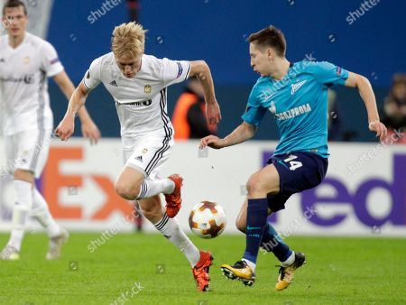 Birger Meling, Daler Kuzyayev. Rosenborg's Birger Meling, left, fights for the ball with Zenit's Daler Kuzyayev during a Europa League group L soccer match between Zenit St. Petersburg and Rosenborg BK at the Saint Petersburg stadium in St. Petersburg, Russia