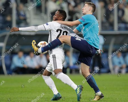 Samuel Adegbenro, Daler Kuzyayev. Rosenborg's Samuel Adegbenro, left, fights for the ball with Zenit's Daler Kuzyayev during a Europa League, group L, soccer match between Zenit St. Petersburg and Rosenborg BK at the Saint Petersburg stadium in St. Petersburg, Russia
