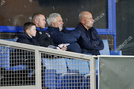 Wayne Rooney sits in a corporate box with his son Kai Rooney, agent Paul Stretford and father in law Tony McLoughlin during the match
