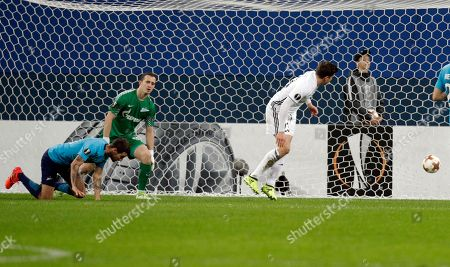 Andre Helland, Andrey Lunyov. Rosenborg's Pal Andre Helland, right, scores past Zenit's goalkeeper Andrey Lunyov during a Europa League, group L, soccer match between Zenit St. Petersburg and Rosenborg BK at the Saint Petersburg stadium in St. Petersburg, Russia