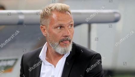 Vienna's head coach Thorsten Fink waits for the start of the Europa League group D soccer match between FK Austria Wien and HNK Rijeka in Vienna, Austria