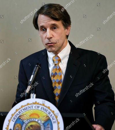 California's insurance commissioner Dave Jones talks during a news conference in Los Angeles on . Jones says preliminary estimates of losses from the state's recent siege of wildfires exceed $1 billion and that the figure is expected to rise. Jones told reporters that the estimate comes from the eight largest insurers in the affected areas