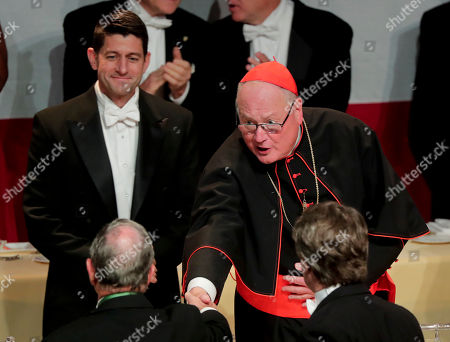Cardinal Timothy Dolan, right, shakes hands with former New York City Mayor Michael Bloomberg as Speaker of the House Paul Ryan, left, looks on during the 72nd Annual Alfred E. Smith Memorial Foundation dinner, in New York