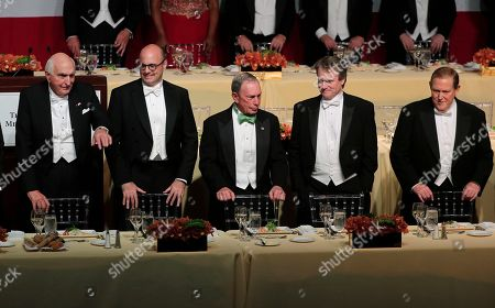 From left, Home Depot co-founder Kenneth Langone, hedge fund manager Roberto Mignone, former New York City Mayor Michael Bloomberg, Bank of America chairman and CEO Brian Moynihan and former CEO of Mutual of America Life Insurance Thomas J. Moran wait to be seated during the 72nd Annual Alfred E. Smith Memorial Foundation dinner, in New York