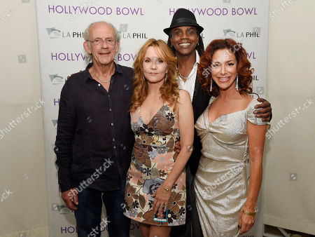 "Left to right, Christopher Lloyd, Lea Thompson, Donald Fullilove and Claudia Wells, cast members in the 1985 film ""Back to the Future,"" pose together backstage before the ""Back to the Future - In Concert 30th Anniversary"" event at the Hollywood Bowl, in Los Angeles"