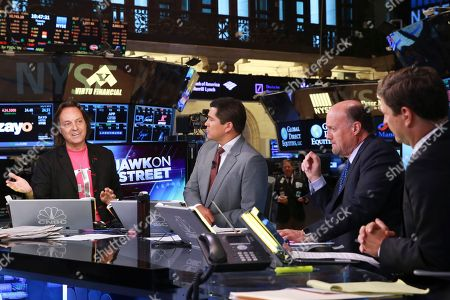 Stock Picture of T-Mobile CEO John Legere discusses the companyâ?™s new â?oeMobile Without Bordersâ?? program with Carl Quintanilla, Jim Cramer and David Faber on CNBCâ?™s Squawk on the Street on in New York