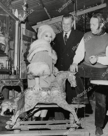American Actor Joseph Cotten And His Actress Wife Patricia Medina (she Is His 2nd Wife) On A Christmas Shopping Spree In Chelsea Antique Market With Antique Dealer Roy Farr. Box 763 40806172 A.jpg.