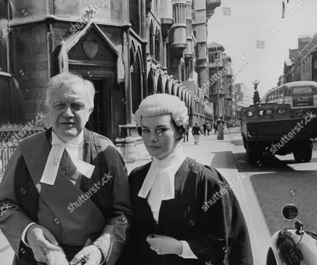 Actor Andrew Cruickshank Who Plays Mr Justice Carstairs And Carol Mauray Who Plays A Barrister In The Play 'alibi For A Judge' At The Savoy Theatre Pictured Outside The Law Courts In The Strand. Box 768 929061727 A.jpg.