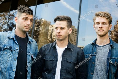 Foster The People's Cubbie Fink, Mark Foster and Mark Pontius, from left, pose for a photograph during the SXSW Music Festival, in Austin, Texas