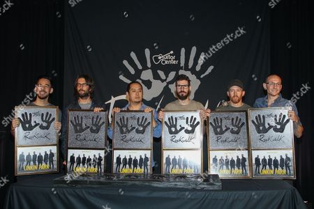 Members of Linkin Park, from left, Mike Shinoda, Rob Bourdon, Joe Hahn, Brad Delson, Dave Farrell and Chester Bennington attend an induction ceremony for the Guitar Center's RockWalk at Guitar Center on in Los Angeles