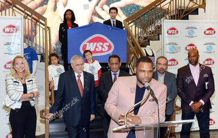 Actor Anthony Anderson and footwear retailer WSS announce the donation of $250,000 to the LA County Alliance for Boys & Girls Clubs to reaffirm WSS' commitment to local youth (L-R) LA County Alliance for Boys & Girls Clubs Executive Director Mary Hewitt, WSS President Mark Archer, Councilman Gil Cedillo, Actor Anthony Anderson, WSS Founder Eric Alon, and Chris Spencer on in Los Angeles